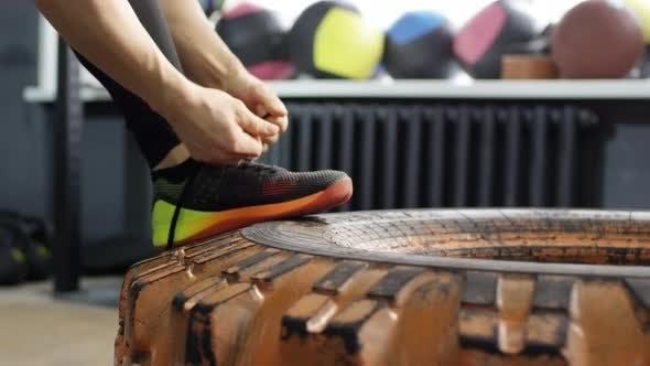 Thumbnail for Female Athlete Tying Shoelaces
