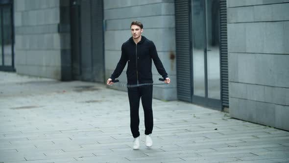 Thumbnail for Sportsman Training Jump Exercise on Skipping Rope. Athletic Man Jumping Outdoor