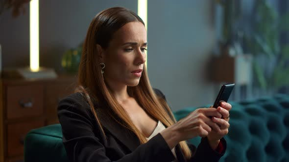 Thumbnail for Focused Businesswoman Using Smartphone at Remote Workplace.