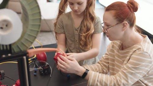 Female Teacher and Intelligent Teenage Girl Building Robot