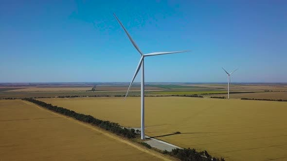 Thumbnail for Aerial View of Windmills Rotating By the Force of the Wind and Generating Renewable Energy.