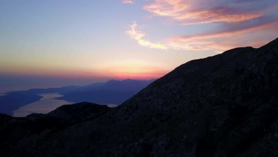 Thumbnail for Aerial drone view of a sunset above a lake in Montenegro