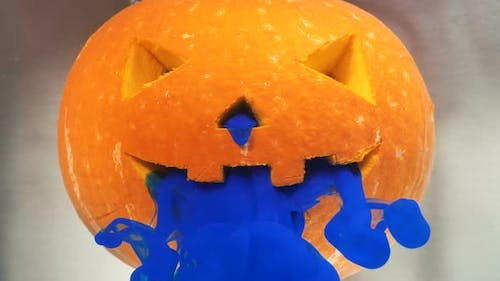 Special Paint of Blue Colour Appears From Pumpkin Cut Face