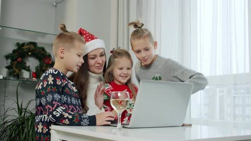 New Year's Concept Mom Her Children Christmas Costumes Make Online Call Laptop