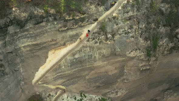 Cover Image for Tourists People Climbs and Coming Down a Steep Staircase Cut Down in a Rock at the Diamond Beach