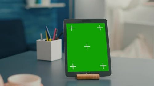 Close Up of Tablet Computer with Mock Up Green Screen Chroma Key Display