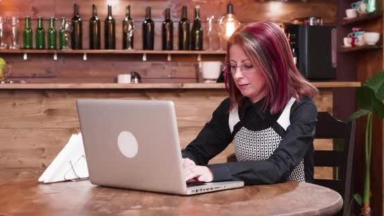 Bringing Coffee To Adult Businesswoman Customer