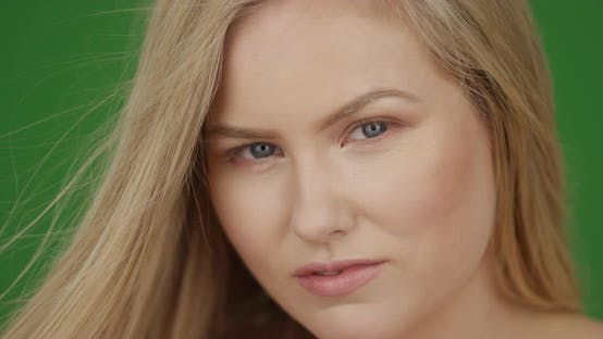 Thumbnail for Portrait of an attractive white blonde young woman on green screen