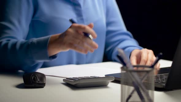 Cover Image for Woman with Calculator and Laptop at Night Office