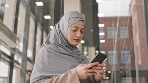 Arabic Woman in Hijab Answering Phone Call