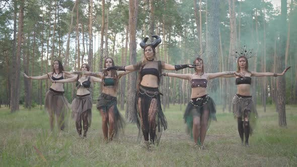 Thumbnail for Young Women in Theatrical Costumes of Forest Dwellers or Devils Showing Perfomance in Enchanted