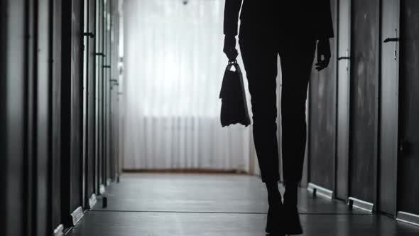 Cover Image for Silhouette of Woman Walking along Hallway