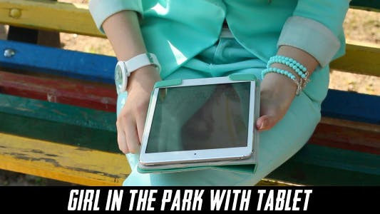 Thumbnail for Girl In The Park With Tablet 2
