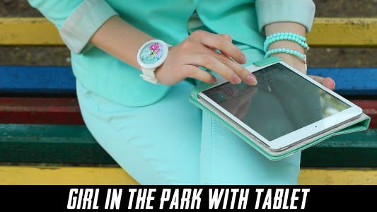 Thumbnail for Girl In The Park With Tablet 3