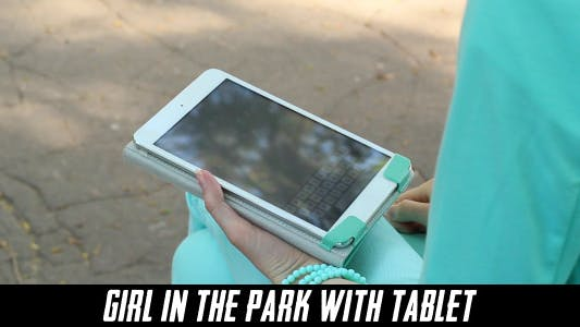 Cover Image for Girl In The Park With Tablet 4