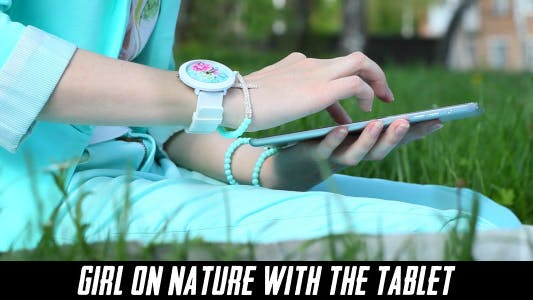 Cover Image for Girl On Nature With The Tablet 9