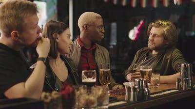 Friends In Bar In Evening