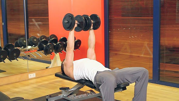 Thumbnail for Handsome Muscular Man Exercises at the Gym