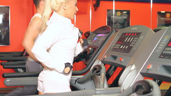 Thumbnail for Sporty Couple Running on Track at the Gym