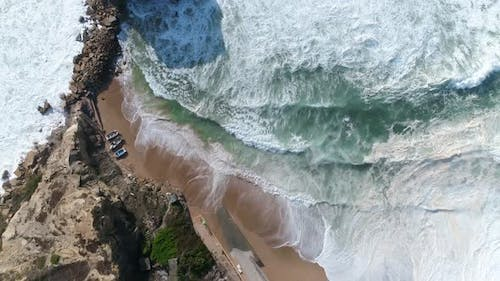 Golden Beach with Deep Blue Ocean Water and White Foam, Aerial Drone View