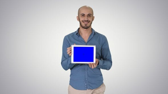 Thumbnail for Arab man walking and showing tablet presenting something