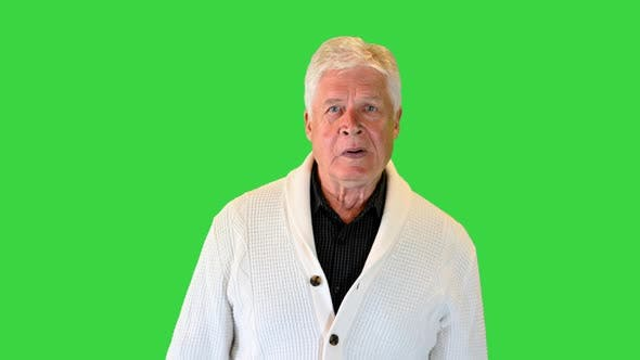 Thumbnail for Senior Greyhaired Businessman Walking Forward on a Green Screen Chroma Key