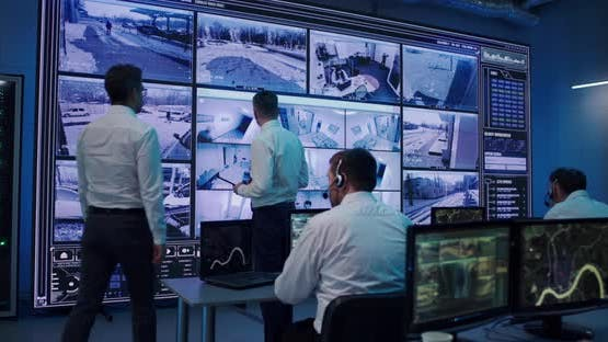 Men Discussing Security Footages in Office
