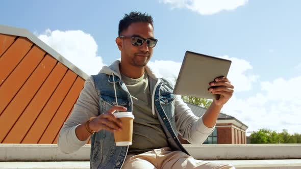 Cover Image for Man with Tablet Pc Having Video Call on Roof Top