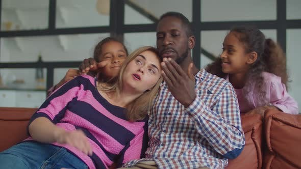 Thumbnail for Cheerful Diverse Family with Kids Relaxing on Sofa
