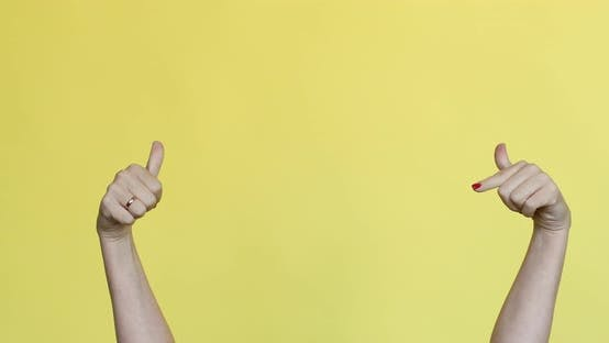 Thumbnail for Female Hands Gesturing at Something on Yellow Background.