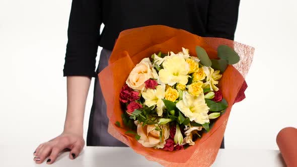 Thumbnail for Florist Turns a Beautiful Colorful Bouquet. White. Close Up