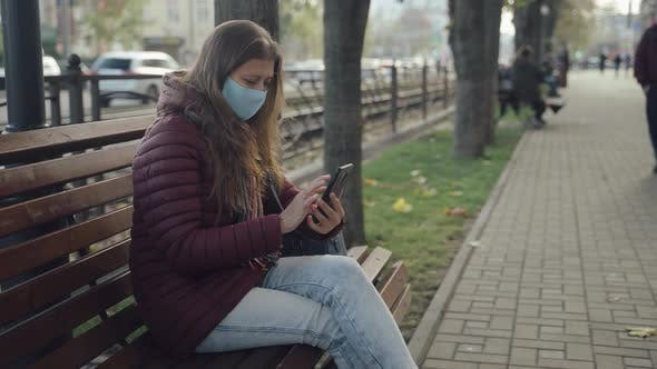Thumbnail for Woman Wearing Face Mask To Protect Against Covid-19 Virus Walking City