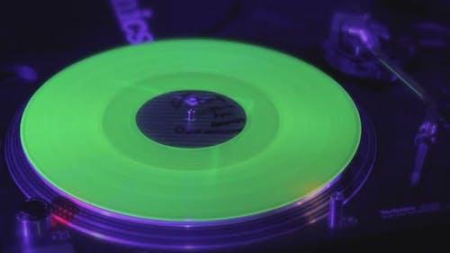 Closeup of Record Rotating on Deejay Turntable, Lights Flashing
