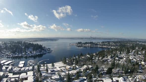 Thumbnail for Amazing Winter Sun Aerial Over Lake Washington Snowy Residential Houses