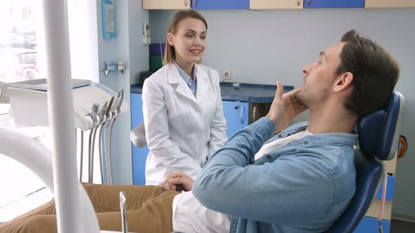 Thumbnail for Female Dentist Talking to Patient about Treatment