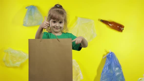 Girl Activist with Cellophane and Paper Packages. Reduce Plastic Pollution. Save Ecology Environment