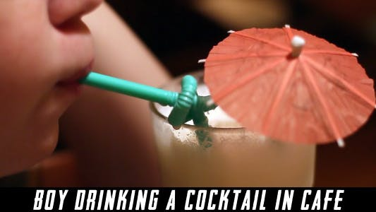 Thumbnail for Boy Drinking A Cocktail In Cafe