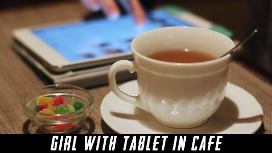 Thumbnail for Girl With Tablet In Cafe 6