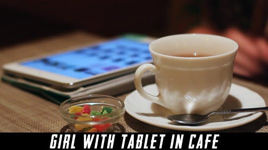Cover Image for Girl With Tablet In Cafe 7