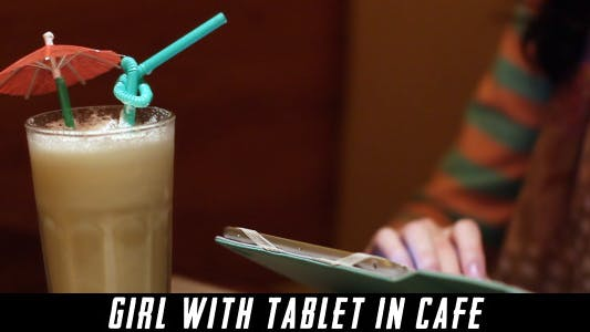 Thumbnail for Girl With Tablet In Cafe 8