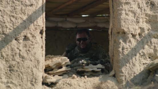 Man Guarding Desolate Building During War