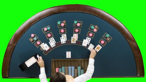 Thumbnail for Dealer at the Poker Table Lays Chips Under the Game of Poker. Green Screen. Top View