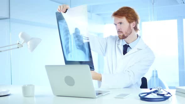 Thumbnail for Serious Doctor Examining X-ray of Patient, Lungs and ribcage