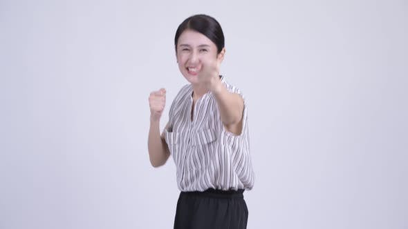 Thumbnail for Happy Beautiful Asian Businesswoman Ready To Fight