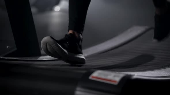 Thumbnail for In the Frame of the Athlete's Legs on a Treadmill. Running Is an Excellent Cardio Load. The Gym for