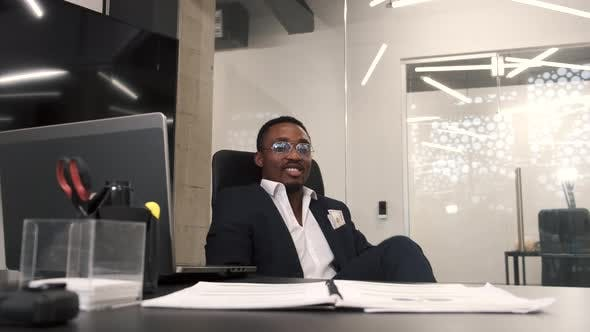 Thumbnail for African American Businessman with Heap of Money in Office