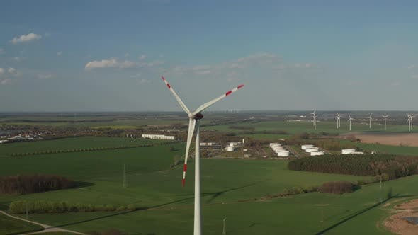 Thumbnail for AERIAL: Close Up Shot of Wind Turbine, Mill Rotating By the Force of the Wind Generating Renewable