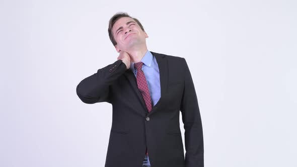 Cover Image for Young Stressed Businessman Having Neck Pain