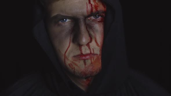 Thumbnail for Man Executioner Halloween Makeup and Costume. Guy with Blood on His Face