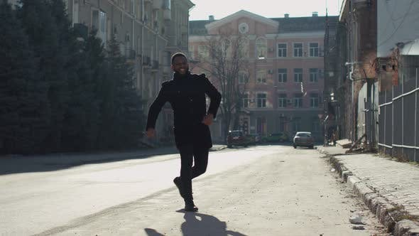 Excited and Happy African American Man Victory Jumping at Empty Street and Run Away